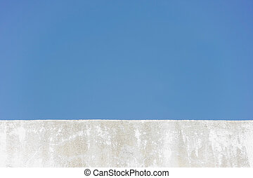 edge wall with sky - edge of wall roof of building with blue...
