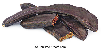 Edible carob fruits over white background