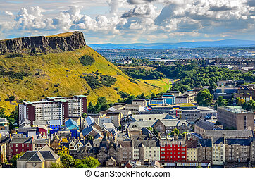 Edinburgh citiscape view with houses and Salisbury crags,...