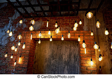 Edison light bulb hanging on a long wire. Cozy warm yellow light.Retro