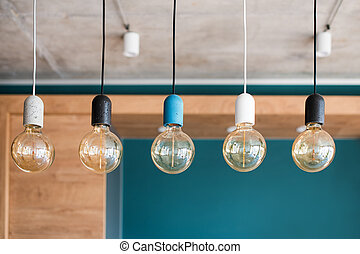 Edison retro lamps. Incandescent bulbs on grey wall background in loft. Concept of vintage style