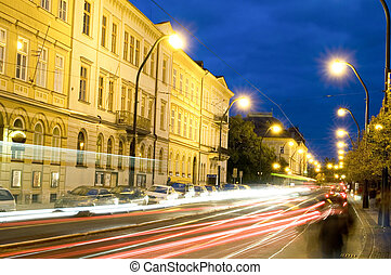editorial night scene boulevard car tram light streaks...