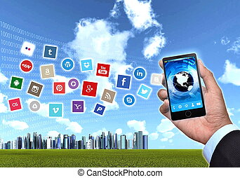A generic smart phones hold by a businessman hand showing famous social media application icon.