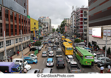Editorial use only City view of Anawrahta Rd. Many high building and Lots of cars, in rush hour traffic jam heaviest.