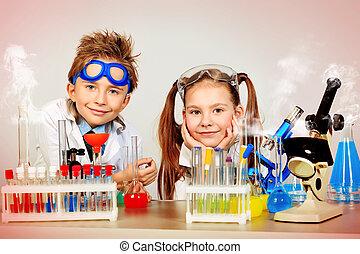 edu children - Two children making science experiments....
