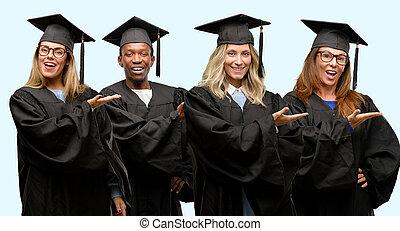 educación, concepto, universidad, graduado, mujer y hombre, grupo, tenencia, algo, en, vacío, mano
