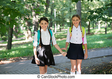 Educating little minds. Happy children back to school. School uniform. Formal fashion. Education and schooling. Knowledge day. Startup. September 1. Nurturing futures.