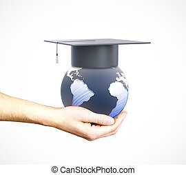 Education abroad - Hand holding globe with mortarboard on...