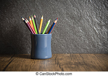 Education and back to school concept with pencils colorful in a pencil case on dark background - Wooden Crayon