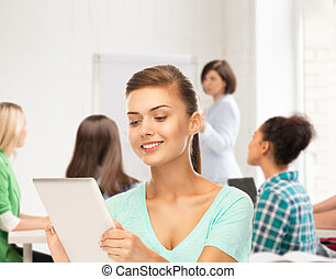student with tablet pc in college