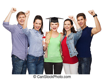 group of standing smiling students with diploma