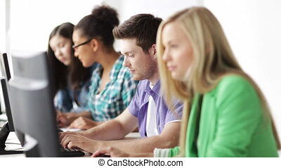 students in computer class - education and school - students...