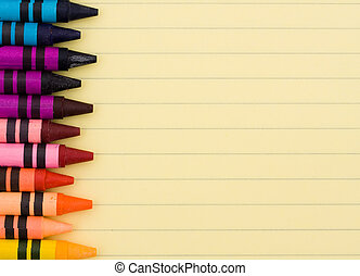 Education background - Colorful crayons on a sheet of lined...