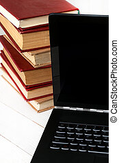 Books with laptop