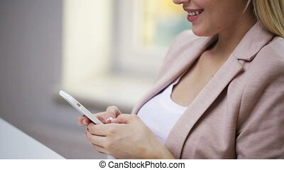 smiling woman or student texting on smartphone - education,...