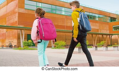 children with backpacks walking from school - education, ...