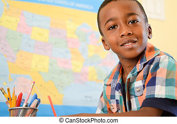 Close-up of an African American boy in school