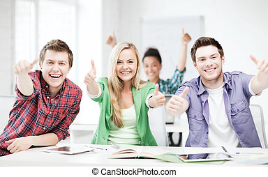students showing thumbs up at school