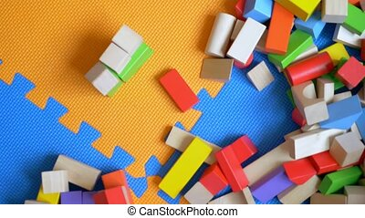 education concept. Multicolored wooden bricks, toy blocks, seen from above against the background of huge puzzles. copy space