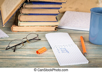Education concept. Notebook page with the word study on wooden table