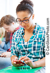 student girl with smartphone at school