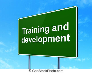 Education concept: Training and Development on green road (highway) sign, clear blue sky background, 3d render