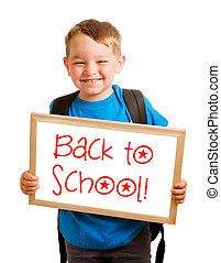 """Education concept with child holding sign that reads """"back to school"""""""
