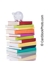 Education cost - piggy bank over a stack of colorful books...