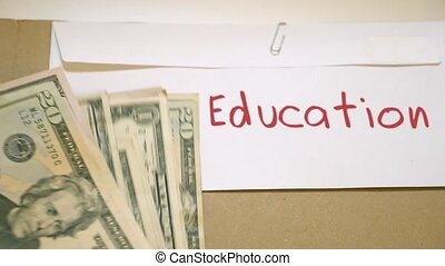 Education costs concept - Education cash envelope
