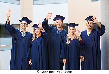 group of smiling students in mortarboards