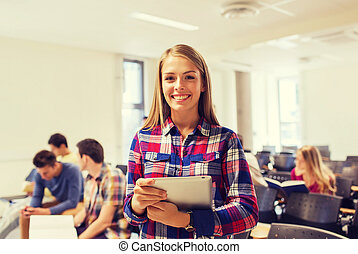 group of smiling students with tablet pc
