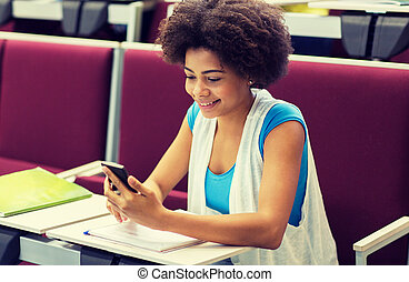 african student girl with smartphone on lecture