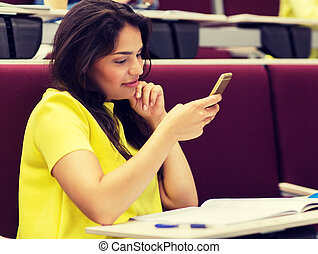 student girl with smartphone on lecture