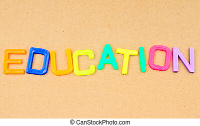 Education in colorful toy letters on paper background