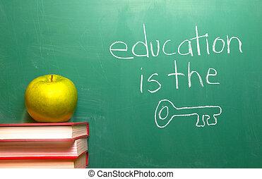 Education is the Key written on a chalkboard.