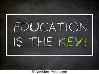 Education is the key - written concept on chalkboard
