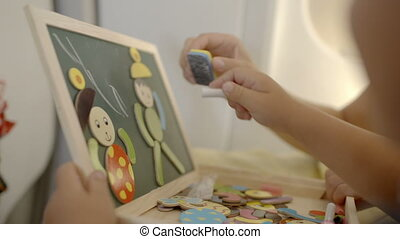 Education of a child with game and drawing