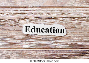 education of the word on paper. concept. Words of education on a wooden background