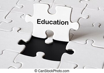 education or school concept with white puzzle