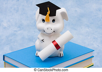 Education Savings - Piggy bank with graduation cap on a blue...