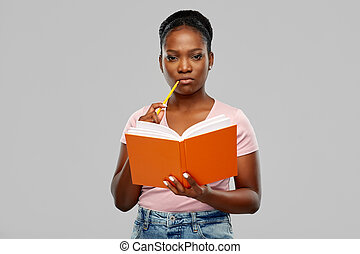 african american woman with notebook