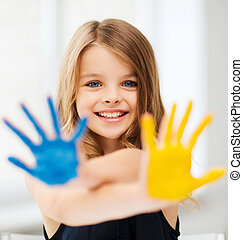 girl showing painted hands - education, school, art and ...