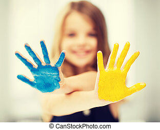 girl showing painted hands