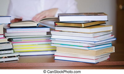 Education school concept. Closeup female girl in college library with books