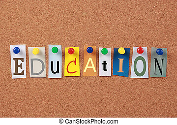 The word Education in cut out magazine letters pinned to a corkboard.