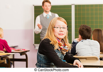 Education - Teacher with pupils in school teaching