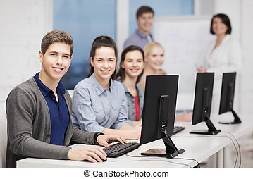 students with computer monitor at school - education,...