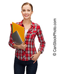 smiling student with folders and tablet pc - education,...