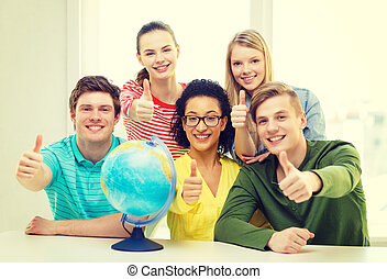 five smiling student with earth globe at school