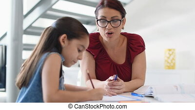 Education With Mom Helping Daughter Doing School Homework At...